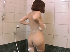 Lovely Asian milf Norie Takahata plays with dildo and takes shower