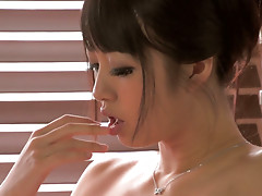 Japanese beauty Kotomi drills her pussy with dildo
