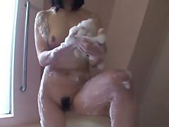 Japanese teen Makoto Kamo takes buble shower