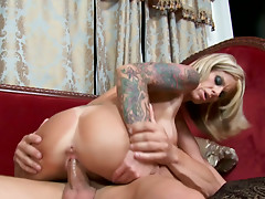 Naughty mom Olivia with huge fake boobs sucking cock and riding on top