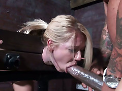 Giant cock thrusts Ashley Winters in BDSM fuck