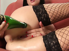 Drunk brunette Sofia fists her pussy with beer bottle