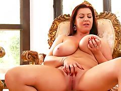 Busty redhead beauty Kora is getting orgasm