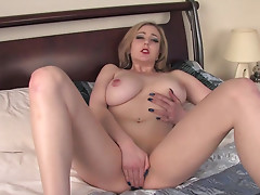 Blonde Megan Sweets is demonstrating her shaved body