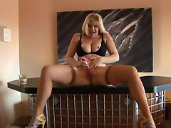 Busty mature milf Dawn Jilling is masturbating
