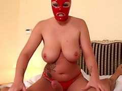 Slender babe in red mask Rubber Ruby is making sloppy blowjob
