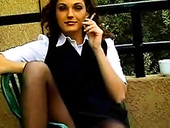 Smoking outdoors in skirt and pantyhose