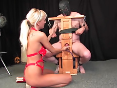 Blonde hurts his cock and balls in bondage