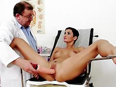 Doctor puts speculum in big tits patient