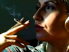Smoking blonde in a sexy temptress