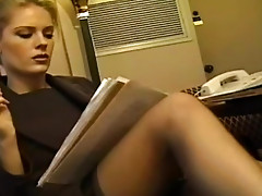 Office babe in stockings and dress