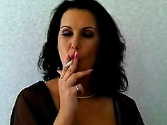 Brunette smokes and plays with her cunt