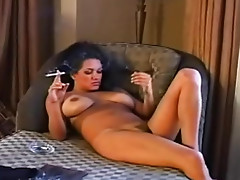 Busty smoking girl puts on stockings