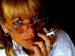 Cute smoking blonde in glasses