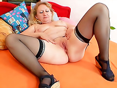 Old lady in stockings fills pussy