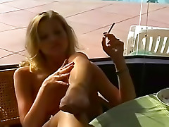 Sexy women smoke topless together