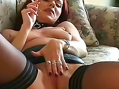 Cool redheaded milf smokes and jills her snatch