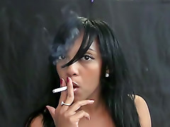 Sexy Latina smokes cigarette sensually