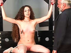 Tattooed girl in nipple torture scene