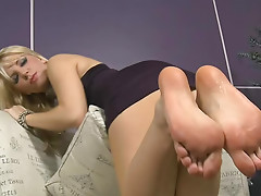 Gorgeous blonde Ashley Fires is preparing her feet for amazing footfuck