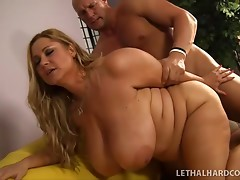 Busty Samantha 38G with big tatas wants her bald bastard to cum on her mammaries