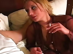 Attractive and incredible cock sucker is doing deep blowjob on the bed