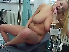 Curvy blonde with big breasts rides toy