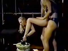 Latex lesbian dominatrix strapon fucks girl