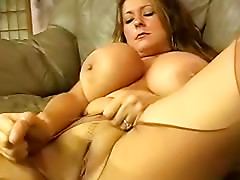 Angel with wonderful melons is playing with her sexy kitty
