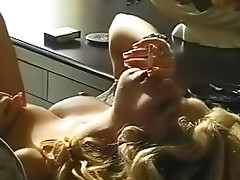 Busty blonde in sensual smoking video