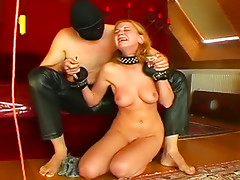 Masked master trains a blonde and whips her hard
