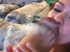 Two hot babes smoking in sexy nylons