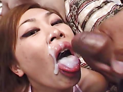 Cute little Asian enjoys two dicks