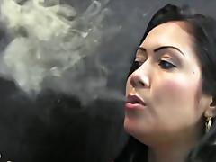 Latina blowing smoke sensually