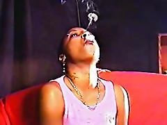 Pierced black girl smokes cigarette