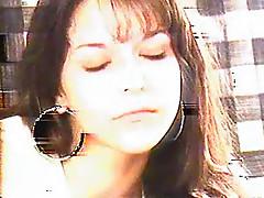Big earrings on girl smoking