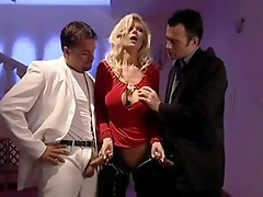 Blonde Woman Captured By Two Men