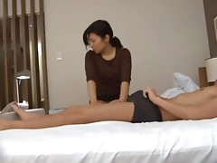 Kinky Japanese chick gives a handjob to some lewd dude