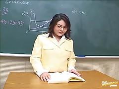 Lewd Japanese milf fucks two guys in the classroom