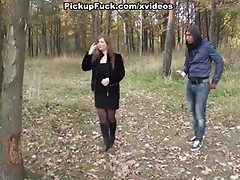 Breasty redhead oral sex in a park