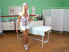Juicy blond nurse Sandy shows what she can do to her sexy patient