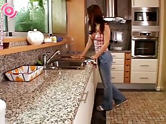 Luscious brunette toys her pussy and ass in the kitchen