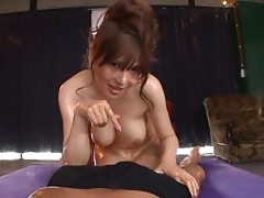 Oiled Anri Okita gives blowjob and titjob to a guy in POV video