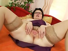 Old grandma with glasses fingering curly slit