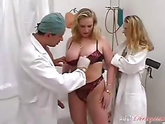 Busty blond fisted at gyno table