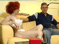 Mature redhead screwed by a youn guy