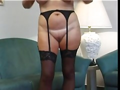 chubby blond granny strips and masturbates with cell phone