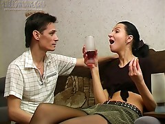 Nik is sexually excited and he's making sure that Candy drinks lots of wine so that guy can fuck her. He knows that once she gets loaded he'll be able to bone her amateur pussy. She's wearing sexy stockings and his first move is to rub his hands up and do