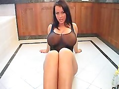 Curvy Lady Oiling Herself Up On The Baths Floor
