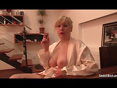 Breasty Blonde in white robe smoking